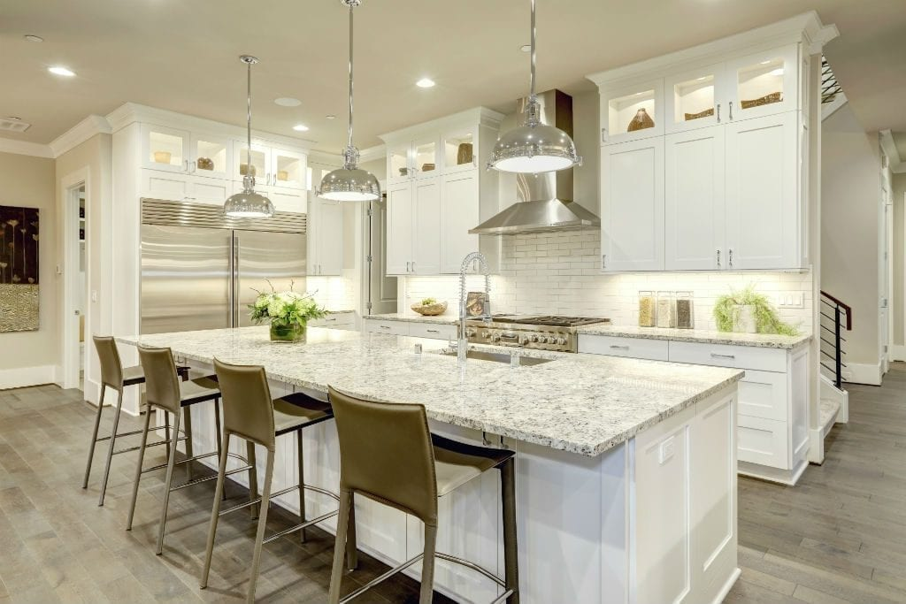 hamptons style kitchen in brisbane with marble island benchtop